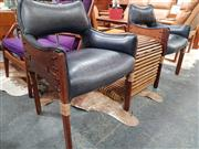 Sale 8822 - Lot 1103 - Pacific Green Pair of Coconut Wood Chairs