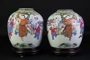 Sale 8902C - Lot 620 - Pair of Early Chinese Jars Featuring Characters Playing (H23cm) on stands