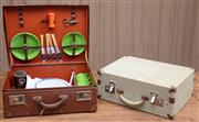 Sale 8984H - Lot 85 - Two picnic hampers, one of suitcase form with cloth exterior, the other a brown leather style example with contents. Larger W48cm