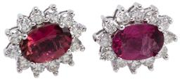 Sale 9246J - Lot 361 - A PAIR OF 9CT WHITE GOLD TOURMALINE AND DIAMOND CLUSTER EARRINGS; each earring centring an oval cut pink tourmaline to surround set...
