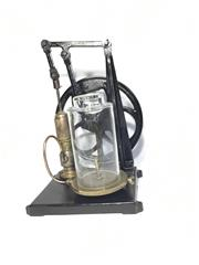 Sale 8579 - Lot 91 - A vintage cast iron and brass vacuum pump with glass chamber. With some tarnishing and wheel siezed. H 52 x W 35cm