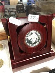 Sale 8789 - Lot 2356 - Silvered Dinosaur Token