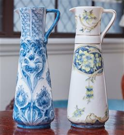 Sale 9103M - Lot 491 - Two tall ceramic jugs with floral decorations, Height 25cm