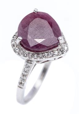 Sale 9213 - Lot 391 - A SILVER RUBY AND TOPAZ RING; heart shaped setting centring a pear cut ruby of approx. 3.48ct to surround and shoulders set with whi...