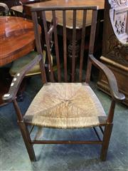 Sale 8666 - Lot 1082 - Provincial Oak Armchair, with slatted back & rush seat, the legs with stretchers