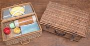 Sale 8984H - Lot 87 - A near pair of  wicker picnic hampers, the smaller with near complete contents. Width of larger 55cm