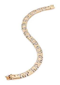 Sale 9213 - Lot 387 - A 14CT TWO TONE GOLD BRACELET; 7mm wide stylised flat Byzantine link in yellow and rose gold to integrated box clasp with safety cli...