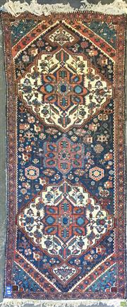 Sale 8617 - Lot 1031 - Persian Afshar Wool Runner, with two red on cream medallions, on a dark field with scattered motifs (390 x 107cm)