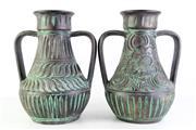 Sale 8994 - Lot 33 - A Pair of Vespa Sesto Terracotta Urns (H 42cm)