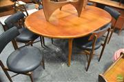 Sale 8364 - Lot 1082 - G-Plan Teak Extending Table and Set of Six Black Vinyl Upholstered Chairs