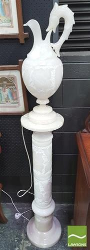 Sale 8428 - Lot 1021 - Alabaster Ewer Shaped Lamp, with leaf capped handle & floral design to body and pedestal column