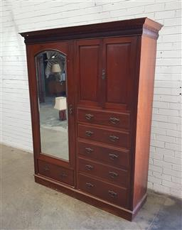 Sale 9142 - Lot 1071A - Early 20th Century Cedar Wardrobe, with long mirror panel door, two short timber panel doors & five drawers, raised on plinth base -...