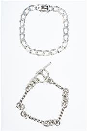 Sale 8293 - Lot 317 - TWO SILVER BRACELETS; flat curb and twist links, wt. 39.8g.