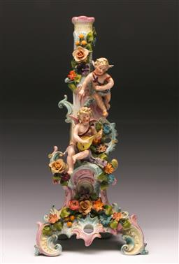 Sale 9110 - Lot 66 - A continental ceramic cherubic detailed figural candle stick (H:37cm)