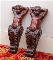 Sale 8804A - Lot 104 - A pair of C19th carved walnut caryatid brackets of cherubs with raised arms, Height x 52cm