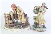 Sale 8913C - Lot 24 - A Capodimonte Figural Group of Carpenter and Pinocchio together with another