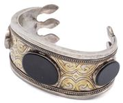 Sale 9074 - Lot 323 - A TRIBAL DESIGN SILVER STONE SET CUFF BANGLE; 32.5mm wide 830 silver bangle collet set with 3 oval onyx plaques to decorative patter...