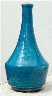 Sale 9066H - Lot 17 - A decorative terracotta bottle vase in a teal glaze. H 34cm