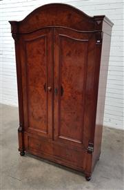Sale 9085 - Lot 1005 - Late 19th Century Figured Walnut Armoire, with arched hood, book matched veneer doors & long drawer below - key in office (h:193 x w...