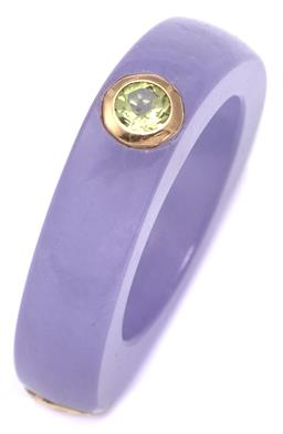 Sale 9115 - Lot 329 - A LAVENDER JADE GOLD GEM SET RING; 6mm wide triangular form treated jade ring, rub set in 14ct gold on the 3 corners, with a round c...