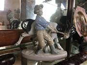 Sale 8730B - Lot 46 - German Ceramic Figure Depicting a Farmboy Restraining a Cow H: 18m