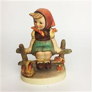 Sale 8456B - Lot 93 - Hummel Figure of a Girl on Fence