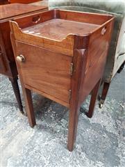 Sale 8814 - Lot 1032 - George III Mahogany Bedside Cabinet, with raised gallery, single door & square legs on castors