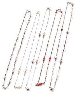 Sale 9145 - Lot 331 - FIVE SILVER BEAD NECKLACES; one bar link interspersed with 4mm cultured pearls, 2 cable links set in groups with corals and faux pea...