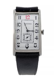 Sale 8522A - Lot 9 - An Art Deco Longines rectangular shaped & curved wristwatch, polished steel case and manual winding, case size without lugs 37 x 25m...