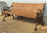 Sale 8745A - Lot 67 - A teak and cast iron bench, W 154cm