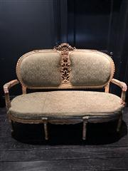 Sale 8761A - Lot 23 - A French antique style carved gilt and upholstered settee with floral decoration (needs repair to arms) Height of back 108cm, W x 15...