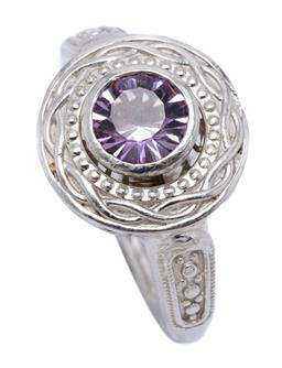 Sale 9213 - Lot 320 - A SILVER SOLITAIRE AMETHYST RING; rub set with a 7mm round amethyst in an articulating collet, top width 16mm, size N, wt. 7.06g.
