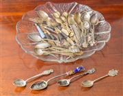 Sale 8470H - Lot 67 - A quantity of various teaspoons and pastry forks, including novelty, Thai, EP and silver on a glass platter of leaf form