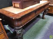 Sale 8444 - Lot 1002 - 19th Century Burr Elm Console Table, originally probably a library table, with cow hide top, above three frieze drawers & on heavi...
