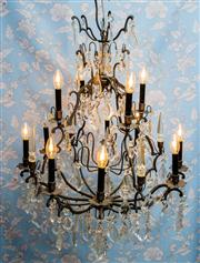 Sale 8577 - Lot 5 - An impressive antique aged bronze Italian two tier and twelve branch chandelier in the French style, featuring large crystal pendalo...