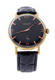 Sale 8522A - Lot 14 - A rare oversized Ulysse Nardin wristwatch, 38mm, circa 1950s black dial watch, hand winding, cleaned & serviced.