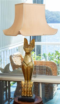 Sale 9164H - Lot 47 - A gilt lacquered seated cat on base adapted for lamp with peach coloured silk shade, total Height 105cm, Height of cat 69cm