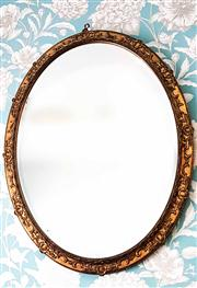 Sale 8577 - Lot 7 - An antique French gold leaf gilded oval mirror featuring a lovely decorative gilded frame, H 90 x W70 cm