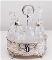 Sale 8369A - Lot 38 - An EP & cut glass 7 bottle cruet set with pierced gallery raised on claw feet, H 26cm