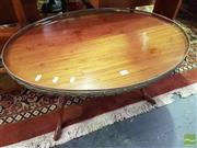Sale 8532 - Lot 1060 - Oval Top Coffee Table on Stretcher Base
