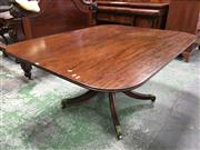Sale 8666 - Lot 1031 - Regency Mahogany Supper Table, the rectangular tilt-top on turned pedestal with outswept legs with brass capped feet