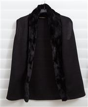 Sale 8902H - Lot 124 - An LS Collection black woollen vest with soft fur-like collar, S-M
