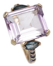 Sale 9083 - Lot 309 - A 9CT GOLD GEMSET RING; set with a step cut pale amethyst of approx. 8.20ct to shoulders each set with a marquise and 3 round cut bl...