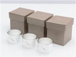 Sale 9255H - Lot 21 - A set of 3 Christofle silver-plated Galaxie & Confetti napkin rings, individually boxed.
