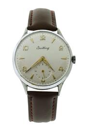 Sale 8522A - Lot 17 - A large vintage Breitling wristwatch, circa 1950s, hand winding, 37 mm, cream dial with golden hands and sub seconds, stainless cas...