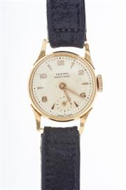 Sale 8293 - Lot 360 - A LADYS 18CT GOLD WRISTWATCH; sunburst dial marked SEXIMA with applied markers, subsidiary seconds on a manual 17 jewell movement t...