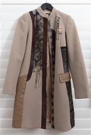 Sale 8902H - Lot 128 - A Fuego Woman caramel coloured coat with zip to front and abstract designs in brown and gold to front, size S