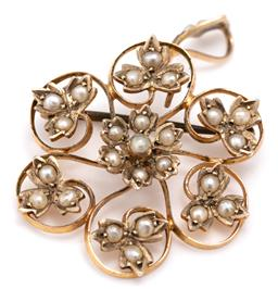 Sale 9115 - Lot 357 - AN ANTIQUE 9CT GOLD PEARL PENDANT BROOCH; centring a floral cluster of seed pearls to scroll tendril surround leaves and bale set wi...