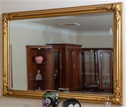 Sale 9155H - Lot 26 - A bevelled edge over mantle mirror in gilt frame with grapevine corners, 87cm x 128cm, Purchased at Buckleys Jan 1999
