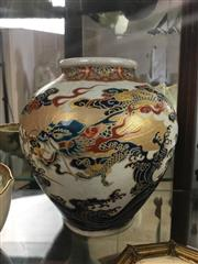 Sale 8730B - Lot 59 - Japanese Vase Depicting a Dragon Flying over the Ocean H: 18cm (Hairline crack to rim)